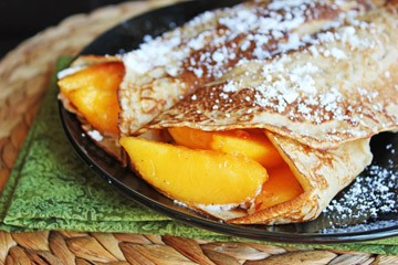 Cinnamon Vanilla Crepes with Fresh Peaches and Cream