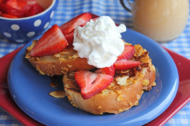 Almond Crusted Cinnamon French Toast with Strawberries and Butter Cream Syrup